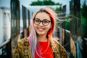 Colored hair young women smiling