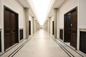 an empty highschool corridor and doors to classrooms